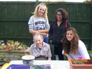 Graham Crawhurst with students in the Brighton home garden.