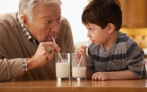 Granddad and grandson and milk
