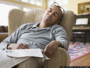 Mixed race man sleeping in armchair
