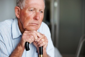 Closeup of an old man lost in thought , loneliness